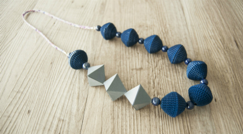 crimped blue paper bead necklace with gray paper geometric beads