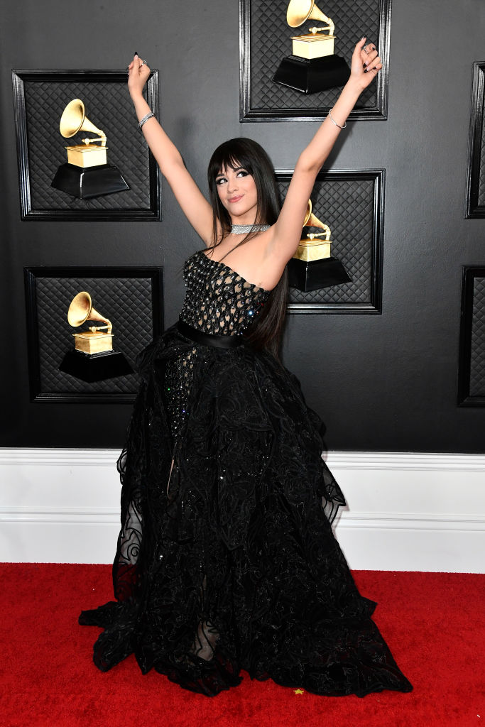 Camila Cabello chose an Atelier Versace strapless mini-dress expertly crafted by soutache weaved leather, enriched with Swarovski crystals. The sculptural overskirt is crafted from a sheer fabric enriched with meticulously hand-embroidered Barocco motifs.