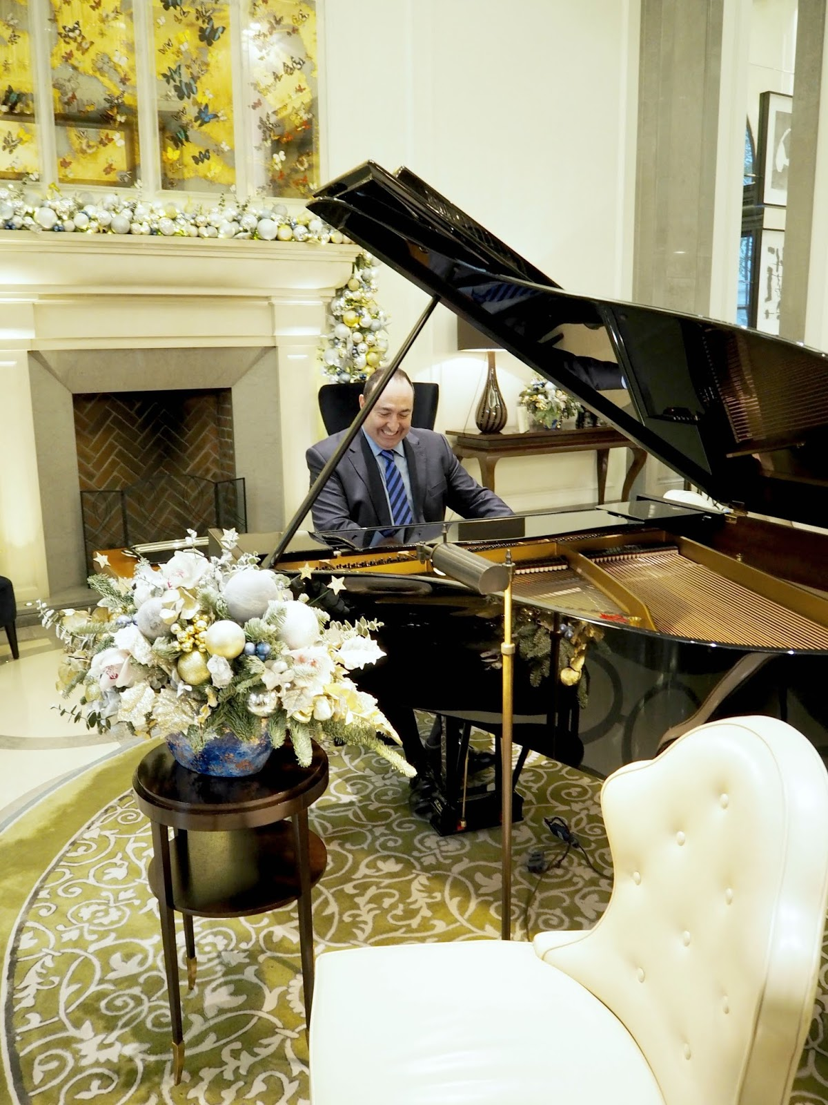 Kevin Lee playing the piano at The Corinthia Hotel