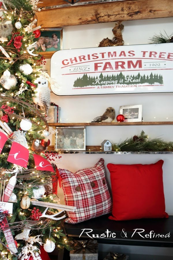 Rustic Decorating Ideas for the home. The entryway decorated for the holidays using red and rustic grapevine adds such texture to any tree.