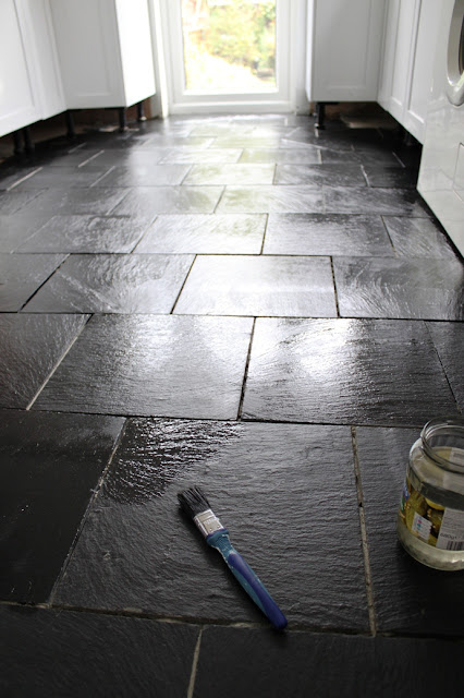 Adding two coats of sealer and two coats of protector to our slate kitchen floor tiles