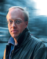 Writer and intellectual Chris Hedges facing the camera with blurry background