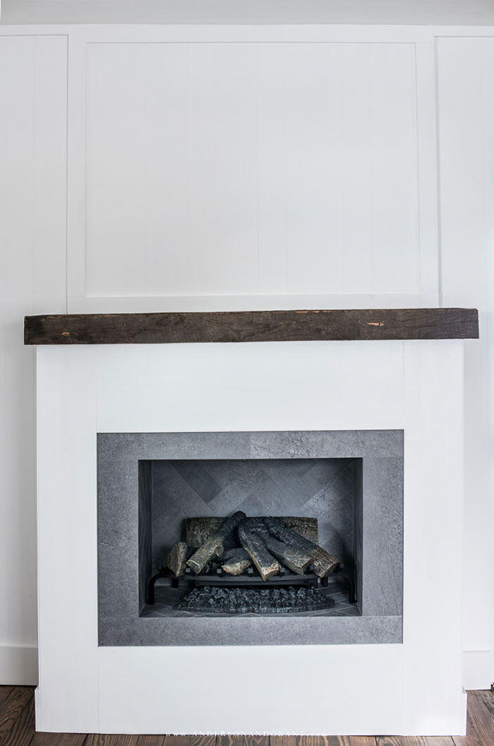 White fireplace with logs