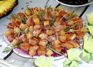 Individually skewered shrimp and pineapple