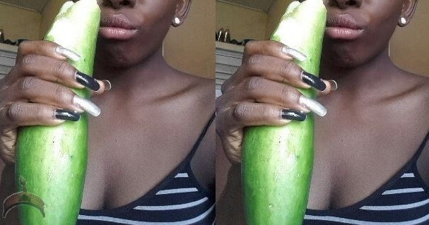 girl-takes-cucumber-in-ass