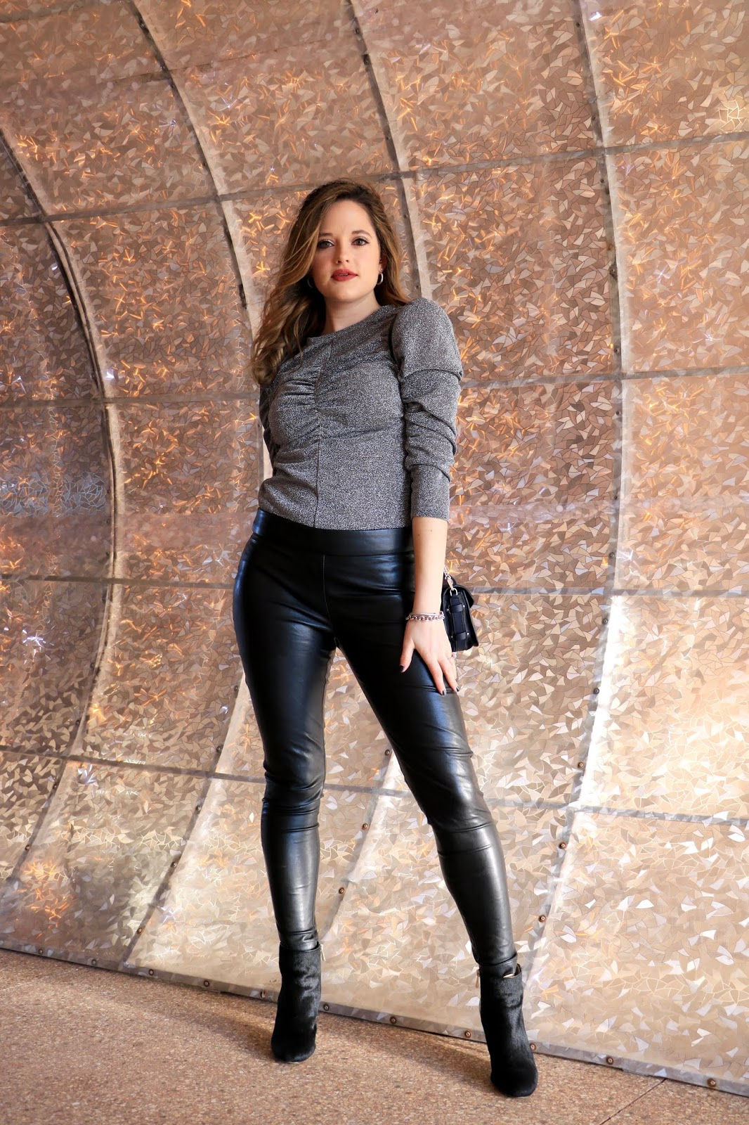 Nyc fashion blogger Kathleen Harper wearing a leather leggings outfit.