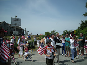 Spectators and bike riders in annual Quisset, MA July 4th parade