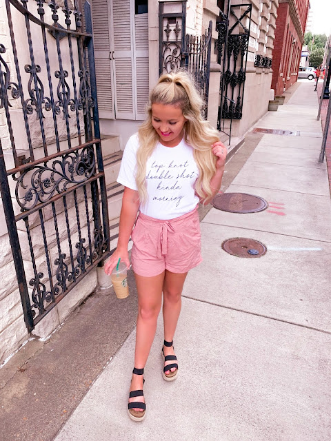 blush paperbag shorts and a graphic tee with espadrille sandals