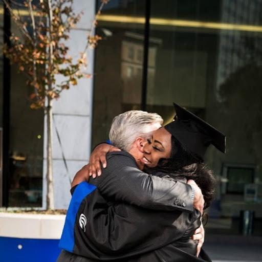 man hugging woman on graduation