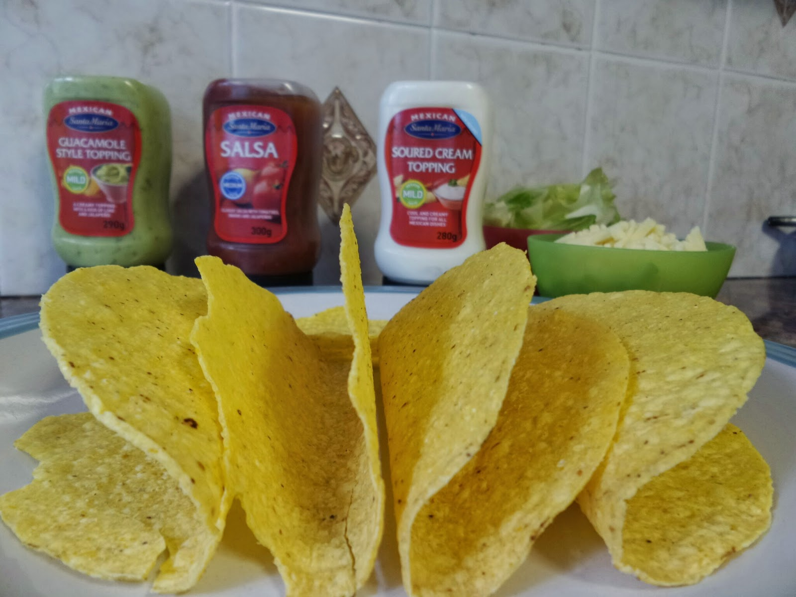 Taco Shells in front of Santa Maria Sauces
