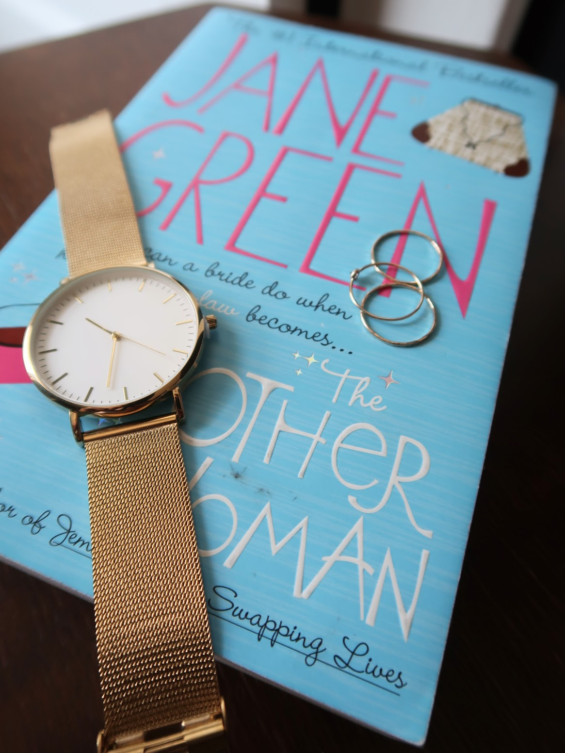 the other woman jane green book review summary rating novel gold watch bedside table ring rings