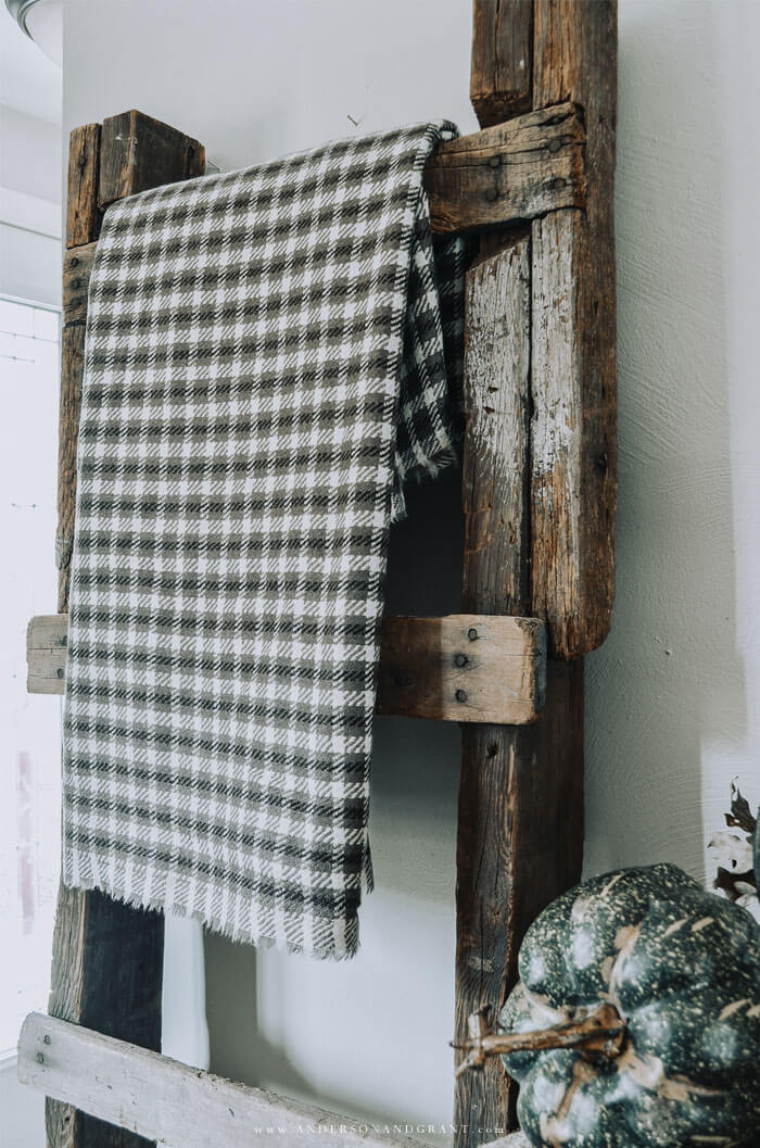 Simple fall decorating - drape a wool throw over a rustic ladder in the room