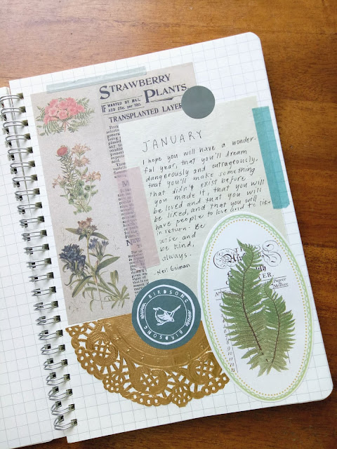 Bullet Journal page for January 2021 filled with stickers and ephemeras