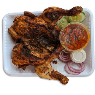 Grilled Chicken And Chilli Sauce Served With Sliced Vegetables & Yaji  On White Background