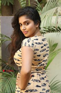 Telugu Actress Karunya Chowdary Stills in Short Dress at ATM Not Working Press Meet  0072.jpg