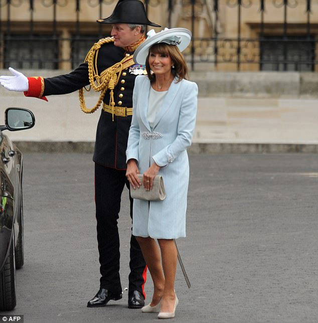 Resplendent in pale blue, Carole Middleton, mother of the bride, at the wedding of Kate Middleton and Prince William