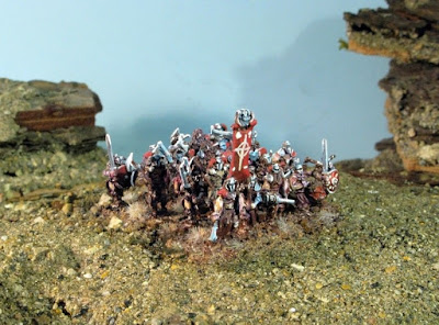 Infantry: 20 individual miniatures including banner and musician, no base included.