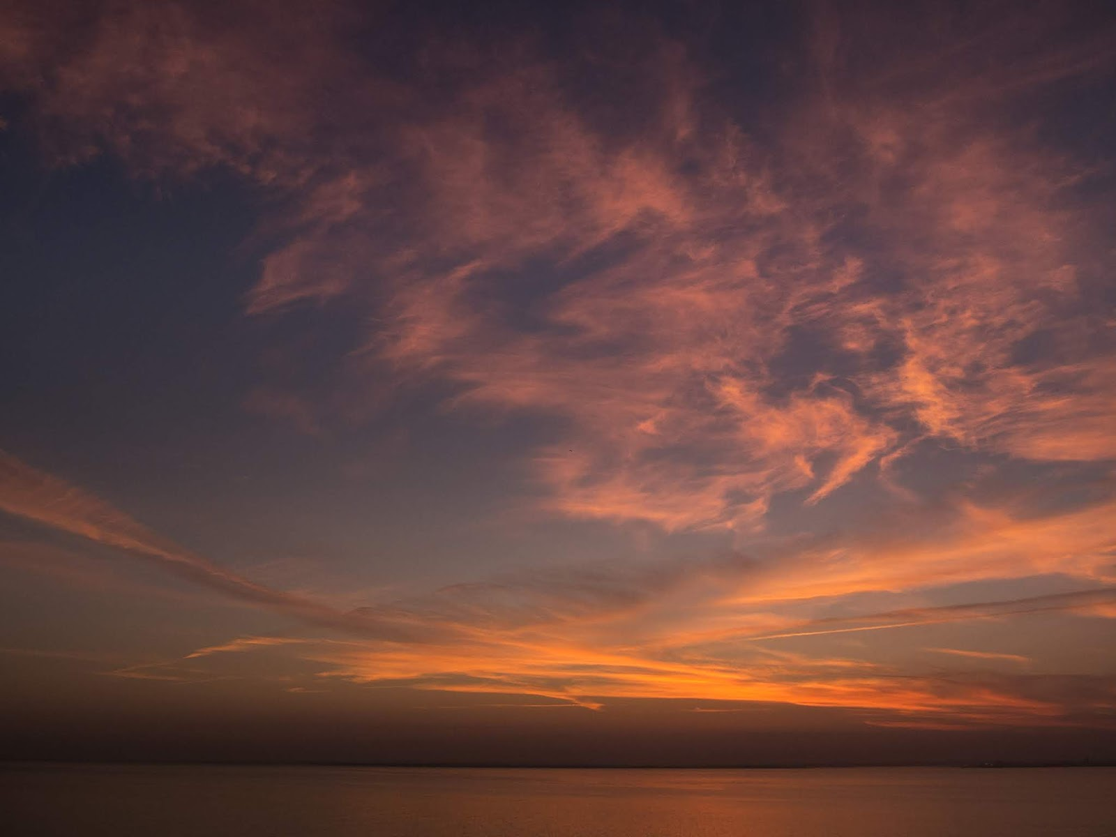 Sunrise clouds over the water captured in Lisbon.
