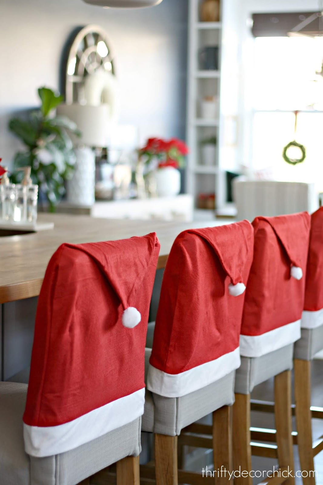 Santa hats on chairs