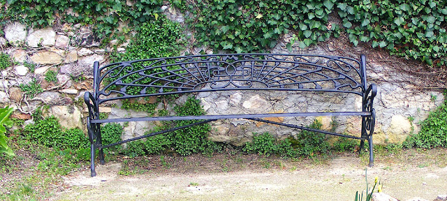 19C cast iron park bench, Descartes.  Indre et Loire, France. Photographed by Susan Walter. Tour the Loire Valley with a classic car and a private guide.