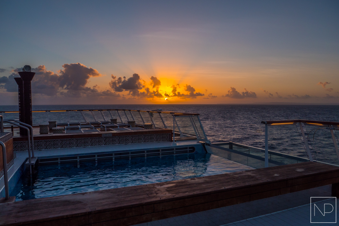 Sunset over the Caribbean onboard Viking Sea, at the back of the ship is an infinity pool