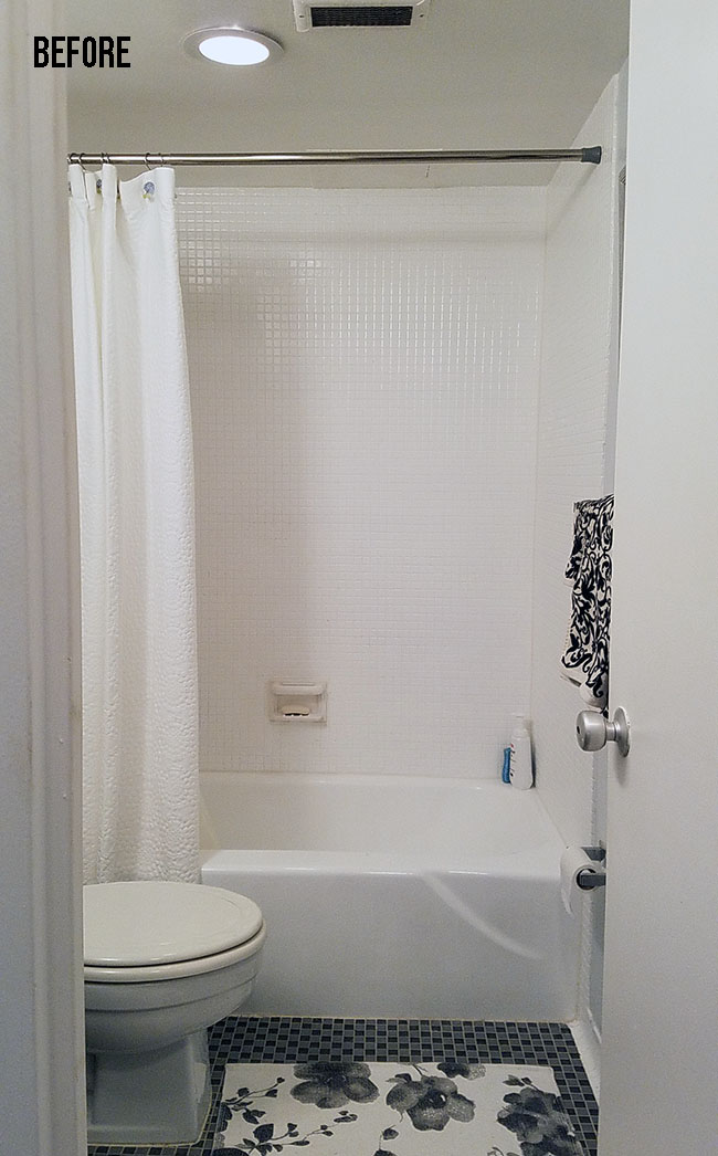 white shower area with bulky tub