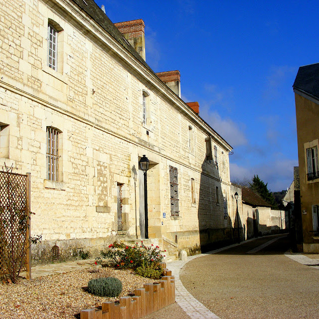 Chateau des Ormes outbuildings along a street in Les Ormes, Vienne, France. Photo by Loire Valley Time Travel.