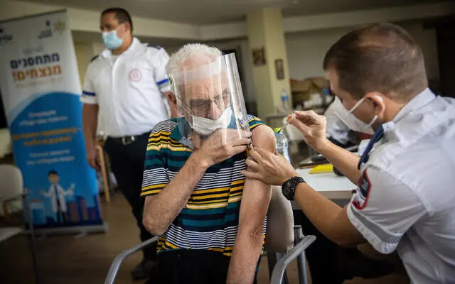 An Israeli nursing home resident receives a third dose of the vaccine, July 4, 2021. Photo: Timesofisrael