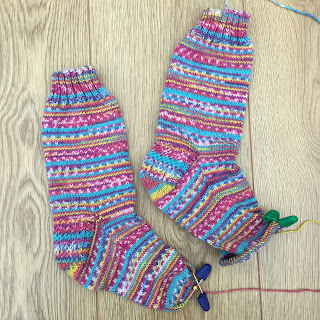 A pair of hand-knit socks in progress