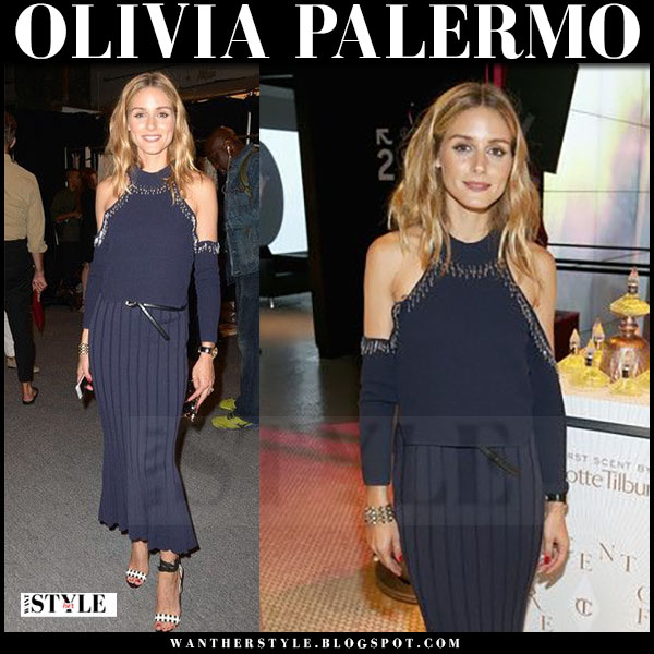Olivia Palermo in navy off shoulder top and navy pleated midi skirt