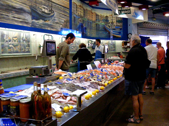 Locals buying fish at the market, Saint Jean de Luz. Pyrenees-Atlantiques. France. Photographed by Susan Walter. Tour the Loire Valley with a classic car and a private guide.