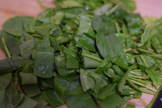 Chopped Spinach on the cutting board.
