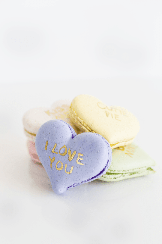http://sugarandcloth.com/diy-conversation-heart-macarons-video-tutorial/