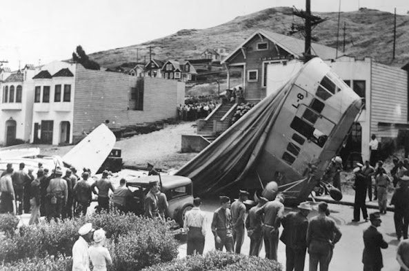 The blimp finally came to rest atop Richard Johnston's freshly waxed car in Daly City, Calif., just south of San Francisco. (National Archives)