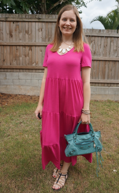 Kmart short sleeve tiered jersey dress in Fuchsia with statement necklace studded sandals and turqouise balenciaga first bag birthday party outfit | awayfromblue