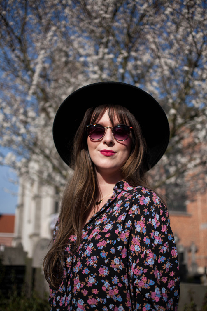 wide brim hat, floral blouse