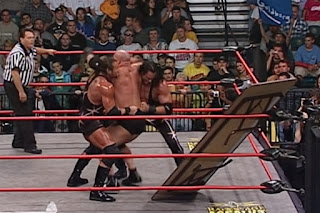 WCW Halloween Havoc 2000 - Kronik try to put Goldberg through a table