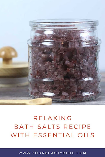 These DIY bath salts are relaxing and help promote better sleep with essenital oils and magnesium flakes. How to make easy bath salts with benefits like helping you relax and stress relief. This homemade recipe makes a great gift.  It uses oils that are safe for kids too. It has lavender, cedarwood, vetiver, blue tansy, and chamomile for natural things to help you sleep. How to use home made bath salts to promote better sleep. #bathsalts