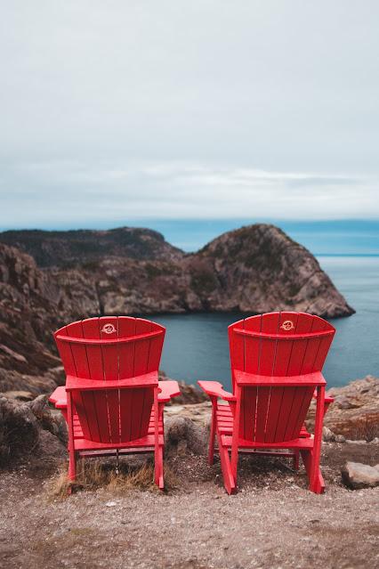 red Muskoka chairs beside the Lake