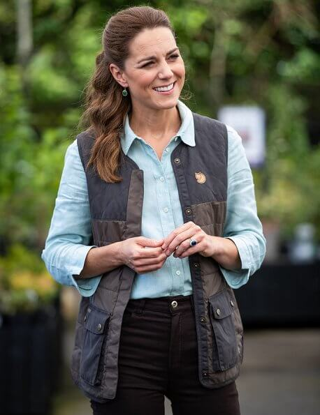 Kate Middleton wore Fjallraven Sormland vest, Jaeger linen shirt, Massimo Dutti satin trousers, Superga sneaker, Monica Vinader earrings