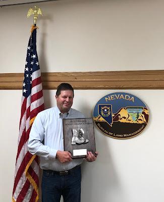 Paul Petersen with award