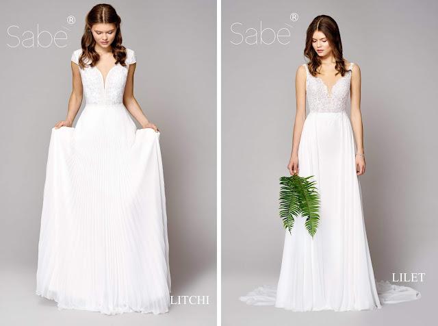 Atelier SABE suknie ślubne. Kolekcja 2019 Ethereal. Suknia ślubna biała, długa, plisowana spódnica, rękawki, ramiączka.