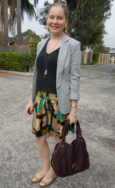 printed silk skirt in office with black tee and grey jersey blazer | away from blue