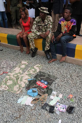 Abia State Police parades fake soldier, his female accomplice, suspected armed robbers and cultists