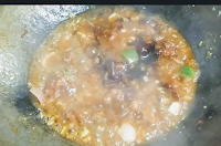 Adding dark soya sauce for Chilli chicken gravy recipe