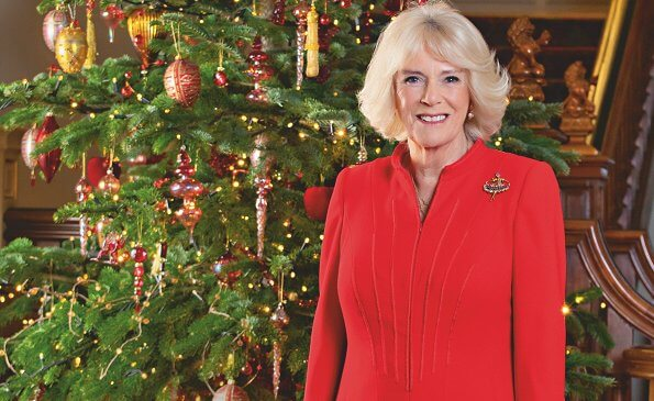 The Duchess of Cornwall wears a red wool coatdress by designer Fiona Clare