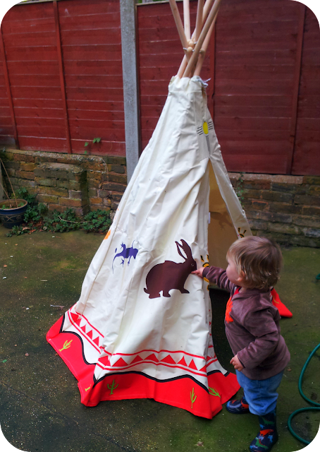 toddler in wigwam, child's garden wigwam