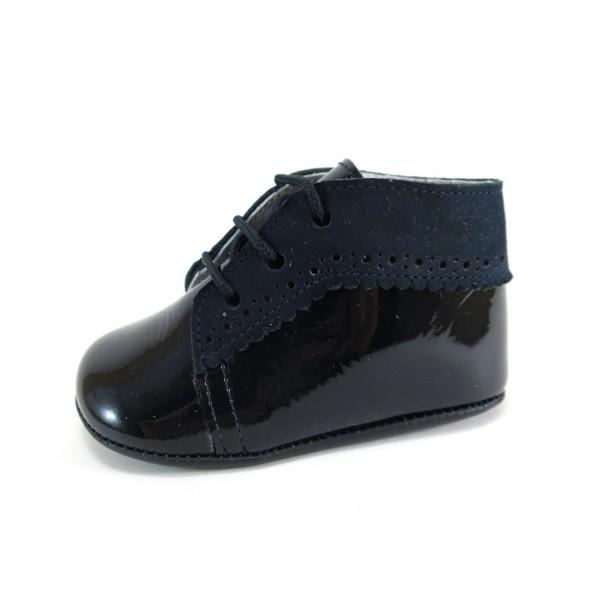 https://www.zapanines.es/zapatos-bebes/3380-botita-charol-y-ante-azul-marino.html
