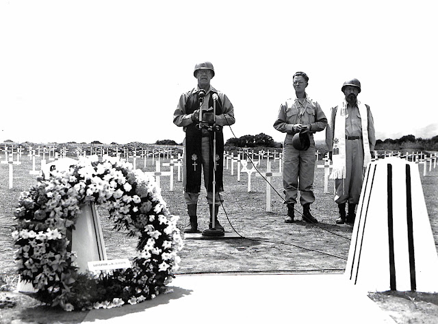 Chaplain Kirker, delivering the first prayer at the Memorial Day services,  for members of the 11th Airborne and 1st Cavalry Divisions.  Chaplain Daly and Chaplain Adler followed.  Taken 30 May 1945.