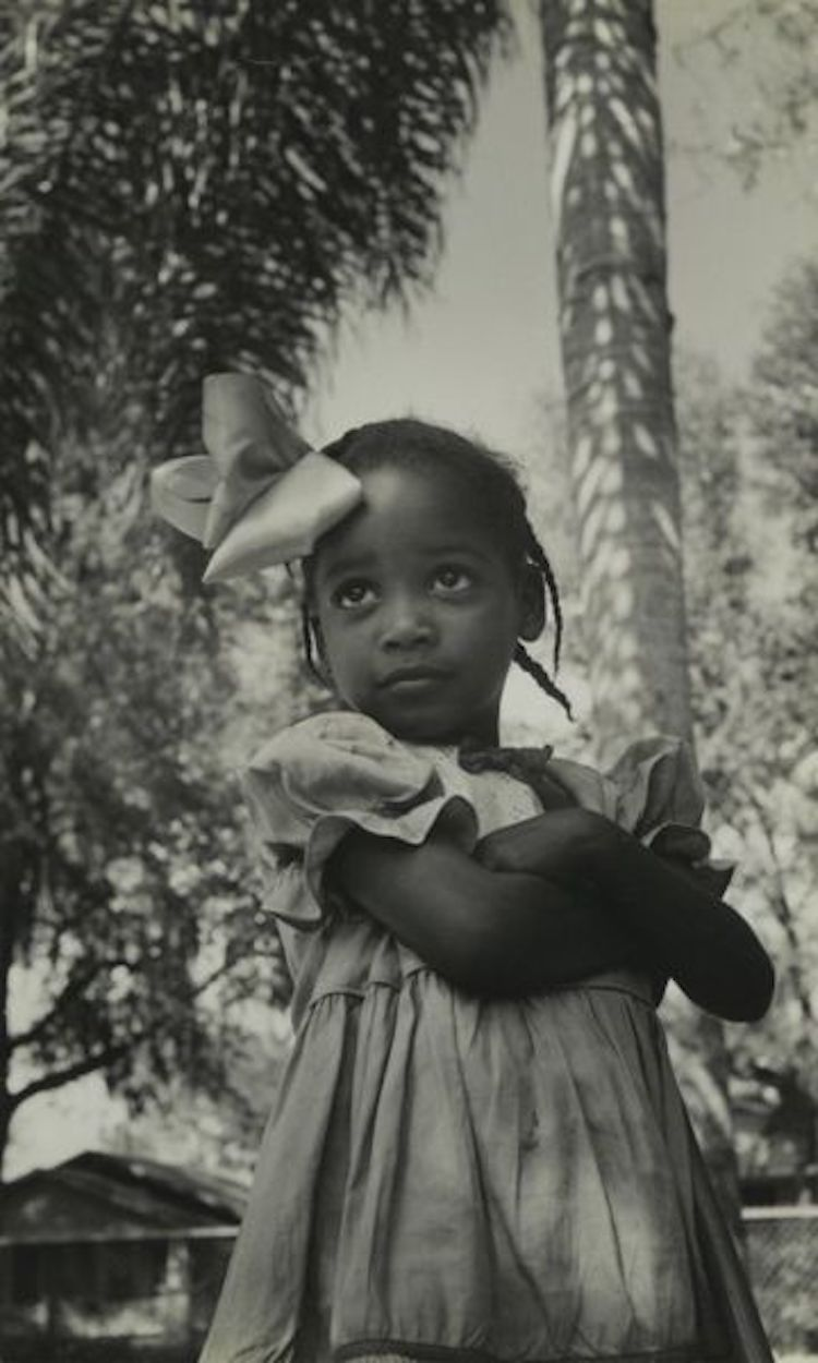 Vintage photo. Adorable little girl. Big bow in her hair and arms crossed. c. 1950s. Little Scraps of Wisdom. marchmatron.com